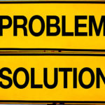 problem or solution, opposite signs. Two opposite signs against blue sky background.