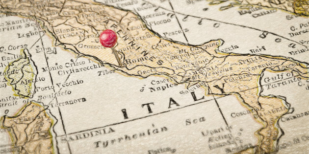 Italy vintage 1920s map with a red pushpin on Rome, digital painting effect applied